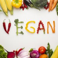 top-view-vegan-lettering-made-out-vegetables-white-background_23-2148290829.jpg